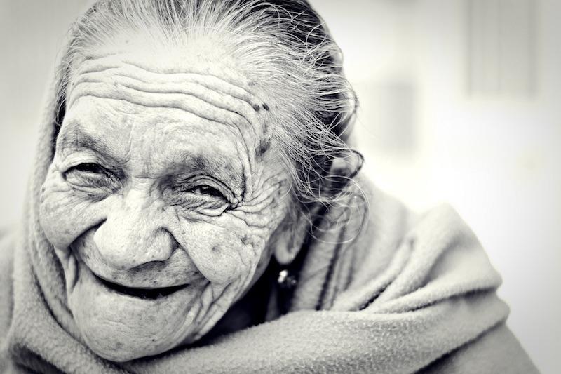Wrinkled elder woman smiling