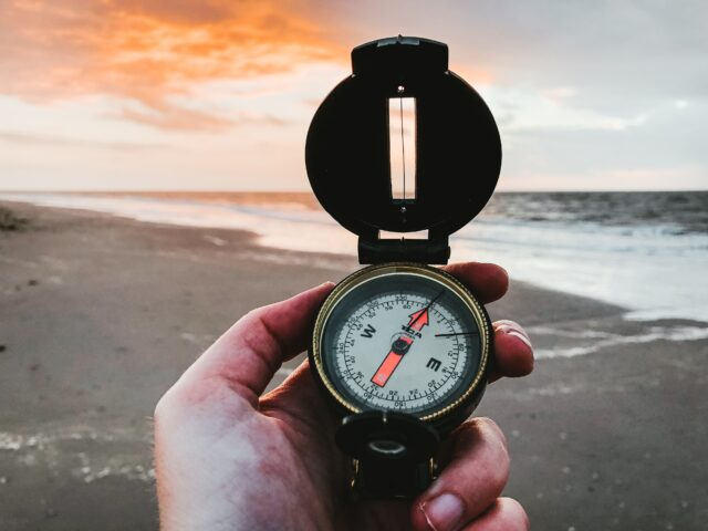 Compass and beach